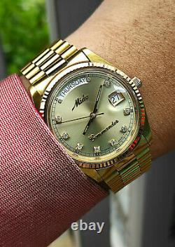 Rare vintage Mido Commander Day Date Mido 8299 Gold Plated authentic swiss made